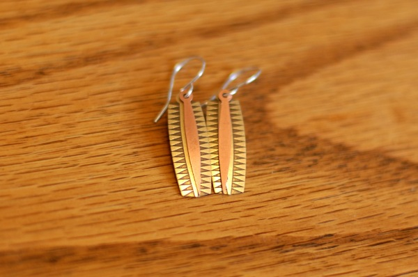 gold and bronze geometric and pendant earrings